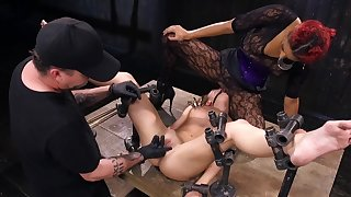 Cold metal is keeping this helpless slavegirl in post