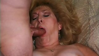 Nasty mature blonde gets her obese cunt choked with young cock